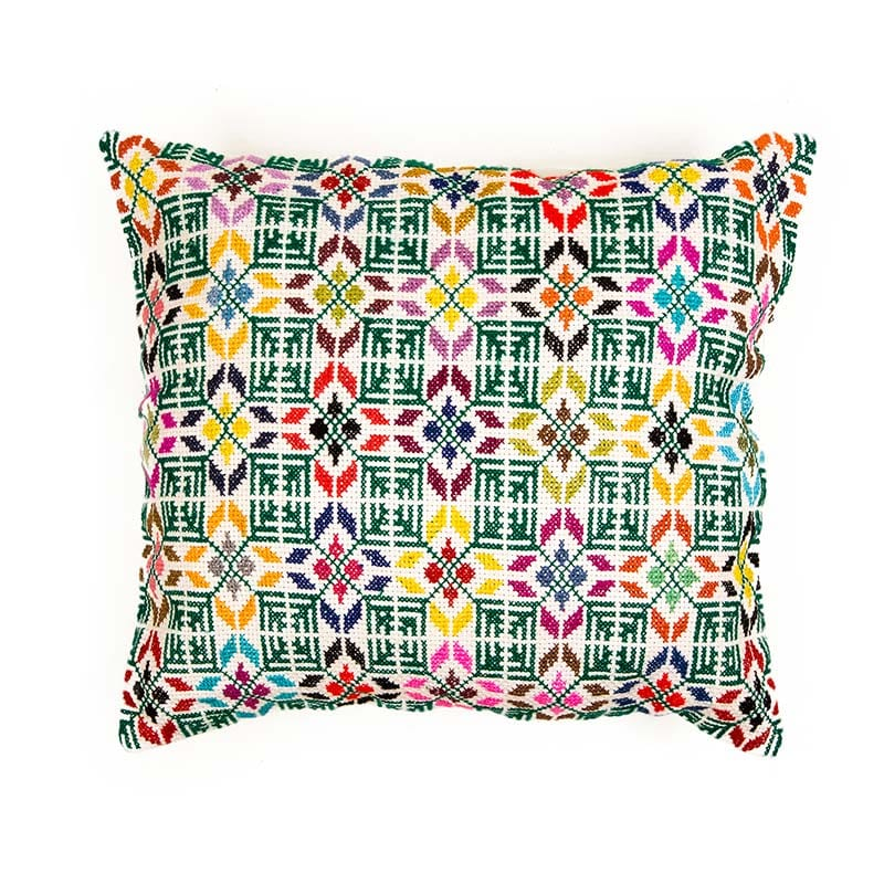 Bright patterned cushion, made in Syria. Striking green square pattern with intricate colourful hand embroidery. 100% cotton thread, backed with 100% linen. Buy fair trade from Beshlie McKelvie.