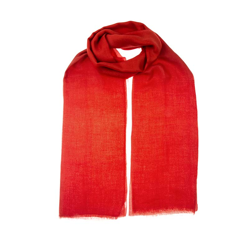 Stunning mandarin red shawl hand woven from 100% cashmere. Individually hand dyed achieves a full depth of colour that is bold and exquisite. Buy fair trade and sustainable fashion from Beshlie McKelvie.