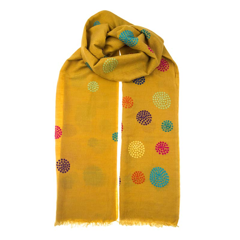 Beautiful mustard cashmere shawl with hand embroidered circle patterns. The colour is hand dyed onto the cashmere repeatedly to get a stunning deep effect. Support local Nepalese artisans with a purchase from Beshlie McKelvie.