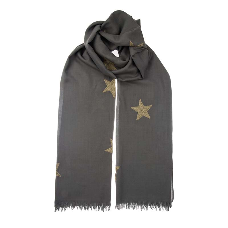 Finely woven olive cashmere shawl with gold stars block printed by hand. With it's silky texture it appears weightless yet is super warm. Buy fair trade scarves from Beshlie McKelvie.