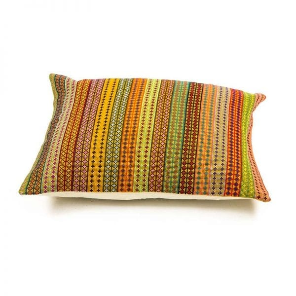 Side view of cushion - Brighten up any room with this beautiful and original hand embroidered Syrian cushion in orange hues. Made of 100% cotton thread and backed with 100% linen. From Beshlie McKelvie in collaboration with Syrian charity Sabbara.