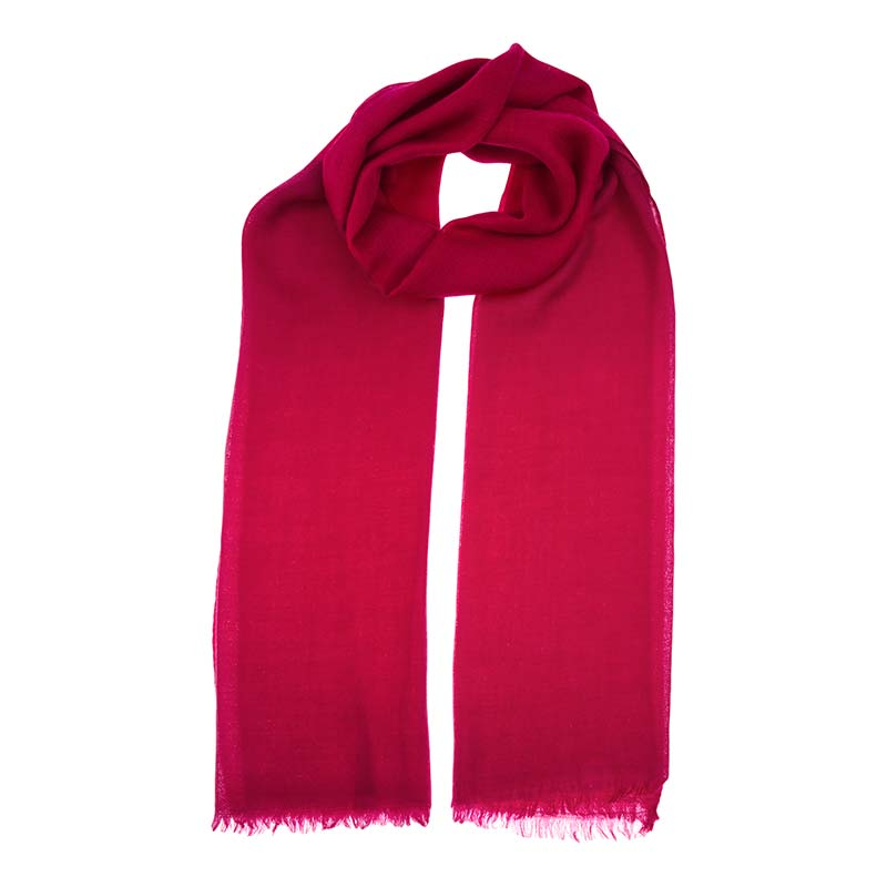 Tango cashmere shawl in a deep rich red colour. The cashmere is hand woven in house and hand dyed from the softest wool of the chyangra goat. Buy ethical fashion from Beshlie McKelvie.