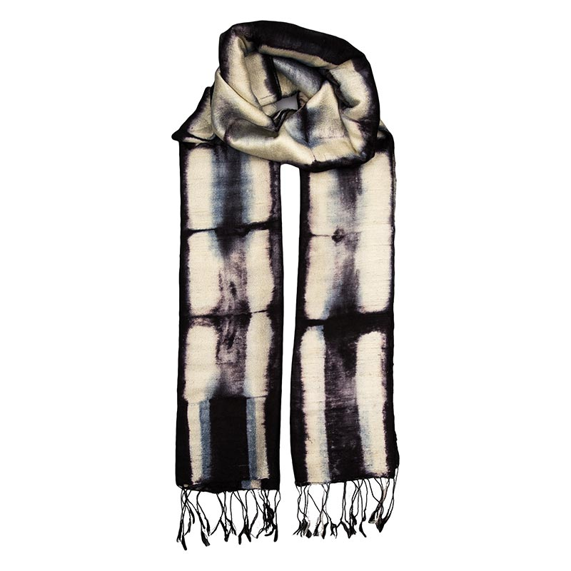 Beautiful 100% silk scarf dyed using one of the oldest techniques from Japan, Shibori. Deep tones are indigo blue and cream. Made by local women in Laos, when buying this scarf from Beshlie you will be directly supporting them and helping to continue their work and traditions. Laos is an ethnically diverse country with unique textile traditions. Our support of local womens co-operatives focuses on taking care of the environment, honouring and respecting traditions, and paying good wages. Buy fair trade today.