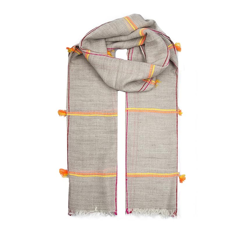 The Coyote scarf is exquisitely hand woven in the himalayas from the finest cashmere. Sumptuous beige with orange thread create a scarf for any occasion.