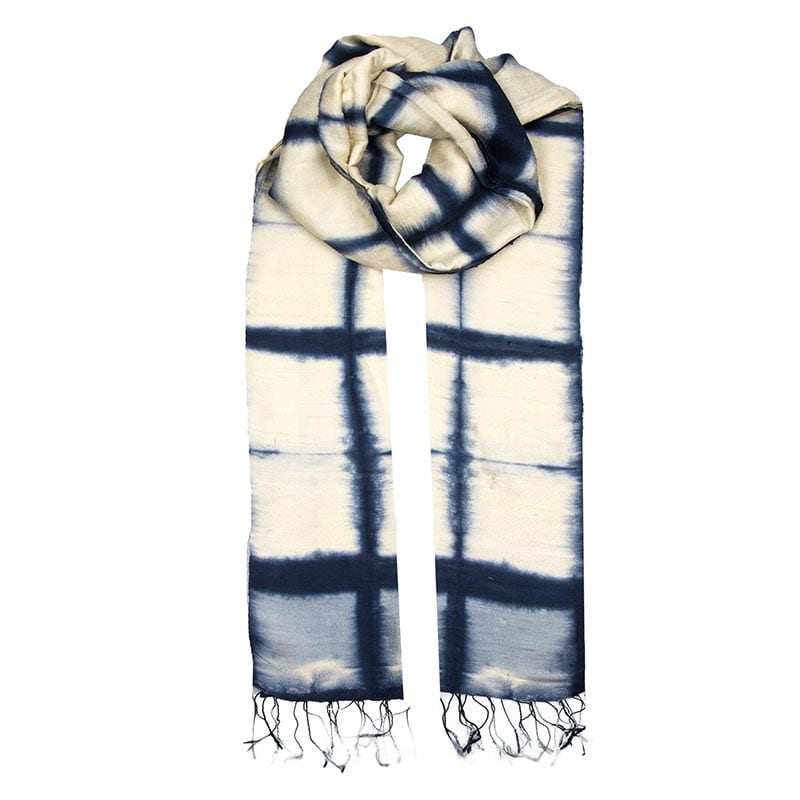 100% soft silk scarf dyed using the traditional method of Shibori. Beautiful cross panel pattern effect in deep indigo tones with cream. Handmade in Laos.
