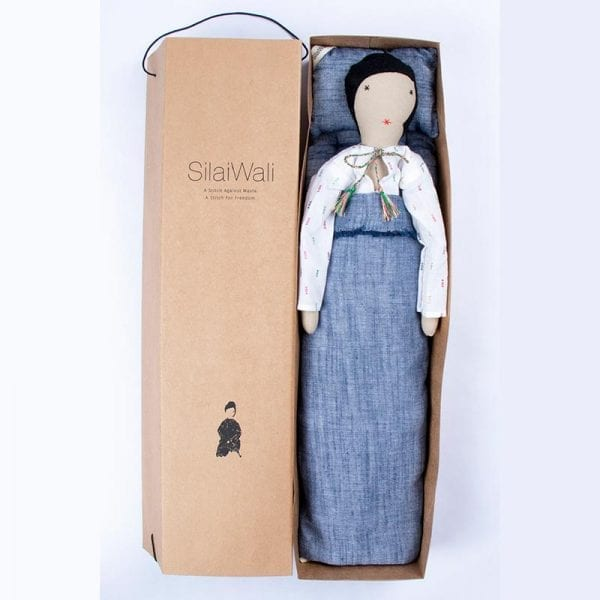 Fair trade doll, Calla, in a white dress comes in her own soft box bed with bedding. The perfect gift for your child to treasure made in India. In soft box with bedding.