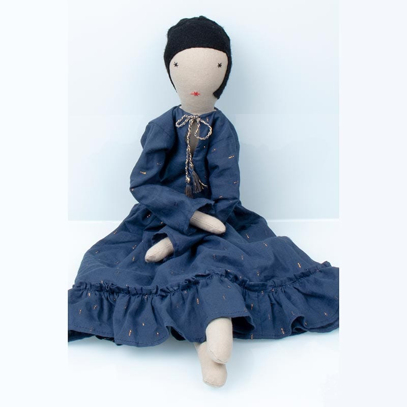 Eco friendly doll Calla 2 comes dressed in traditional blue skirt and white blouse, made from off cuts of Indian cotton from the fabric industry.