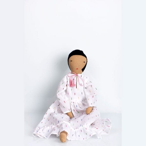 Fair trade doll, Calla, in a white dress comes in her own soft box bed with bedding. The perfect gift for your child to treasure made in India.