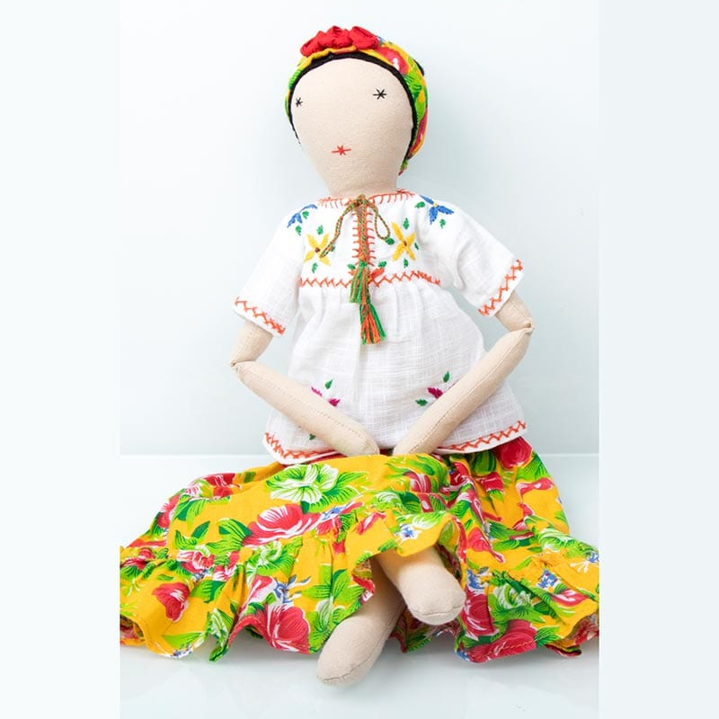Frida doll in colourful, yellow patterned skirt and white blouse. Eco-friendly, supporting sustainable incomes for communities of refugees in India.