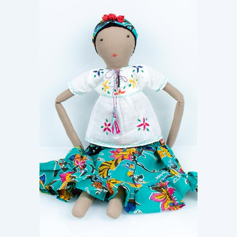 Upcycled Frida doll in green patterned skirt and white blouse. Hand stiched from fabric waste from the clothing industry in India.