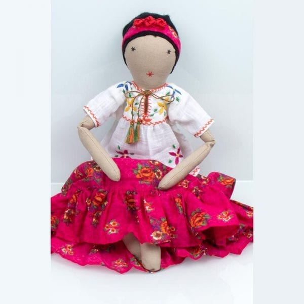 Delight your little one with an ethically made Frida doll in colourful, pink patterned skirt and white blouse. Up cycled from waste fabric in India.