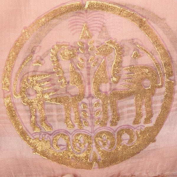 Close up detail of hand woven talisman dupatta is a blend of 80% cotton 20% silk. A one of a kind printed design - gold hand block print on a beautiful soft peach base.