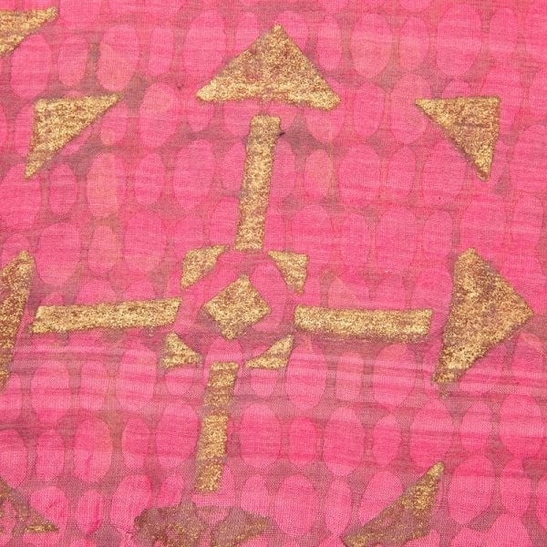 Close up detail of hand woven desert girl dupatta is a blend of 80% cotton & 20% silk in a pretty pink colour with gold hand block print. Made with love in India.